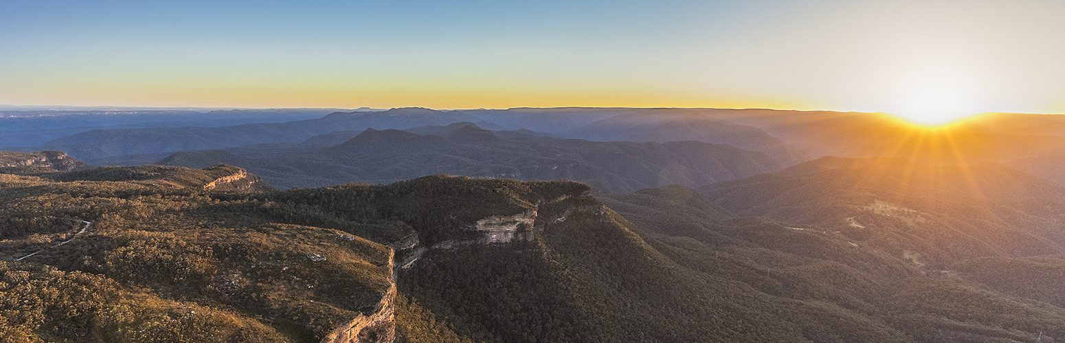 Sun setting over Narrowneck, Katoomba in the World-Heritage listed Blue Mountains National Park.